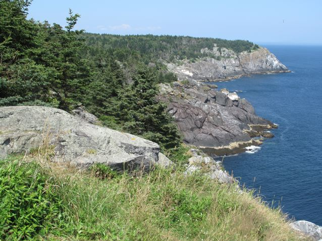 Just looking at the ocean crashing on Monhegan's cliffs is cooling on a hot day. Hilary Nangle photo.