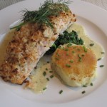 The fixed price menu at 10 Tables at the Bass Cottage Inn, in Bar Harbor, Maine, includes a choice of entrees, such as this Atlantic salmon, herb-horseradish crumbs, dill beurre blanc. Hilary Nangle photo.