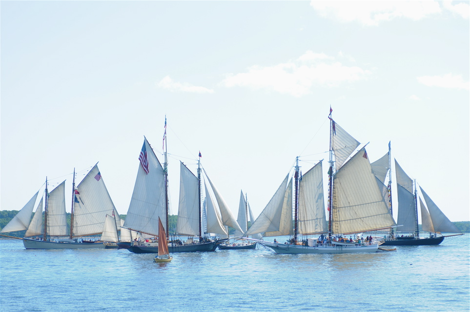 Members of the Maine Windjammer ASsociation fleet parade by the Rockland Breakwater Lighthouse during the annual Parade of Sail in 2011. Tom Nangle photo.