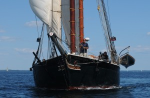 Windjammers sail very close to each other during the annual Parade of Sail, by Rockland Breakwater Lighthouse, in Maine. HEre the Tabor is hard on the stern of the Lewis R. French. Tom nangle photo