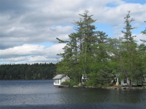 Some of the cabins at Castle Island Camps on Long Pond, in Belgrade Lakes, Maine, are built right over the water. Hilary Nangle photo.