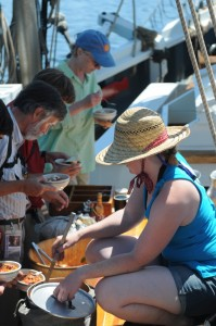 Amber dishes out  Italian Sausage Soup for lunch while sailing aboard the Lewis R. French, a Maine windjammer. Tom Nangle photo.