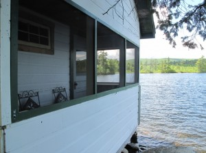 If the water were deeper, you could practically dive out the windows or off the porch from this cabin at Castle Island Camps into the waters of Long Pond. Hilary Nangle photo.