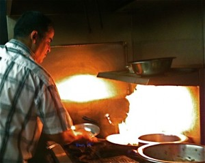 Abraham, who hails from Morocco, cooks up a firey storm in the kitchen at Fez. Hilary Nangle photo.