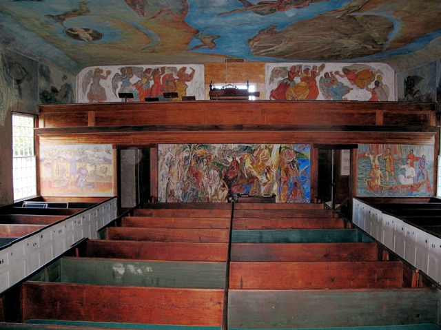The ceiling, walls, choir loft, and entry of Maine's South Solon Meeting House are a riot of color and art. Hilary Nangle photo.