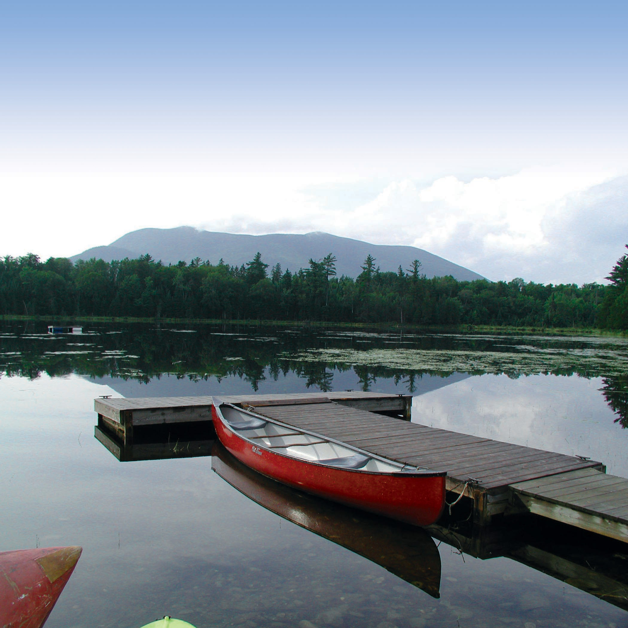 Canoe, fish, or simply dangle your toes in Lyford Pond, one of many remote ponds and streams in the AMC's Wildernes Conservation Lands in Maine. Rob Burbank, Courtesy of AMC