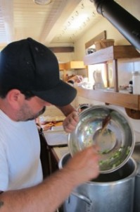 Chef William Howe prepares fish chowder aboard the Maine windjammer Angelique. Hilary Nangle photo.