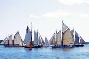 Traditional windjammers parade by the Rockland Breakwater during the Maine Windjammer Association's annual Parade of Sail. Tom Nangle photo