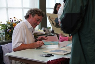 One of the highlights of Wyeth Day at the Farnsworth Museum is Jamie Wyeth signing exhibiton catalogs.