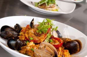 One of Chef Mitchell Kaldrovich's signature dishes at the Sea Glass Restaurant is Gulf of Maine seafood and lobster paella.