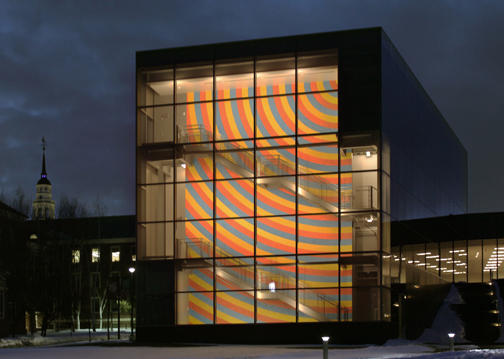 The three-story wall drawing on the stairway of the new Alfond-Lunder wing at Colby College Museum of Art  by Sol LeWitt is illuminated at night. Colby College Museum of Art Courtesy of the Estate of Sol LeWitt