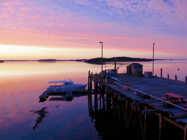 At sunset, gaze over Passamaquoddy Bay from the Inn at the Wharf in Lubec. ©Hilary Nangle