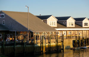 Watch yachts to and fro in Southwest Harbor from Beal's Lobster. ©Hilary Nangle