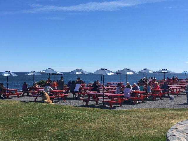 When it comes to views fro Maine lobster shacks, it's hard to beat theopen ocean, ledges, and lighthouse from The Lobster Shack at Two Lights. ©Hilary Nangle
