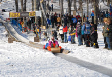 Participate in or watch the annual tobogganing championships at the Camden Snow Bowl.